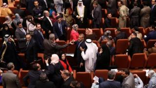 Iraqi MPs argue during the first session of the new parliament in Baghdad, Iraq - 1 July 2014