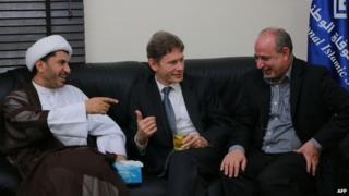 Malinowski with Bahrain's Al-Wefaq opposition group leader Sheikh Ali Salman (left)