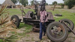 Child on anti aircraft gun