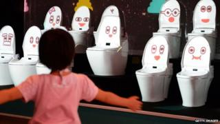 A child dances at a toilet exhibition in the National Museum of Emerging Science and Innovation in Tokyo.