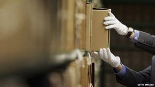 Man removing files from the National Archives