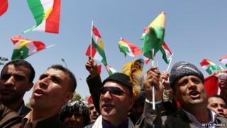 Pro-nationhood demonstrators outside the Kurdish Parliament building on 3 July, 2014.