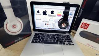 Beats headphones and an Apple laptop