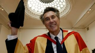 Bryan Ferry wearing his cap and gown