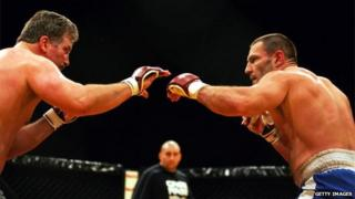 An undated photo of Dave Legeno (right) fighting in a mixed martial arts competition