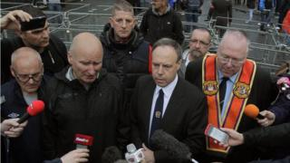 The DUP's Nigel Dodds, PUP leader Billy Hutchinson and the Rev Mervyn Gibson from the Orange Order speak to the media after an Orange Order parade was blocked on its return to the Crumlin Road