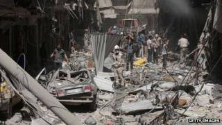Destruction following a reported barrel-bomb attack by Syrian government forces in Aleppo