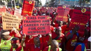 Strikers with placards