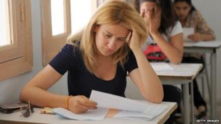 Students take a test in a classroom.