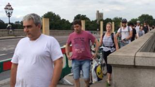 Pedestrians crossing Putney Bridge