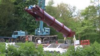 "The ""Archimedean screw"" is lowered into place"