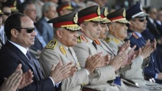 Egyptian President Abdul Fattah al-Sisi and senior military commanders attend a graduation ceremony at Egypt's military technical academy in Cairo (21 June 2014)