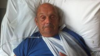 Brian Robinson in hospital bed