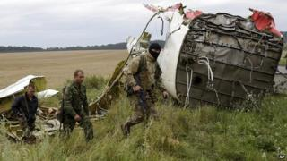 Pro-Russian fighters patrol the site of the crashed Malaysia Airlines plane in eastern Ukraine - 18 July 2014