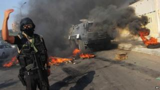 An Egyptian security forces member directs others during clashes against supporters of ousted President Mohammed Morsi in Cairo