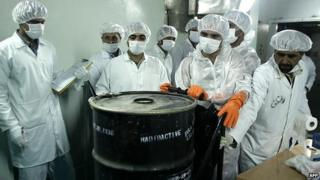Iranian technicians remove a container of radioactive uranium at the Isfahan Uranium Conversion Facilities south of Tehran - 8 August 2005