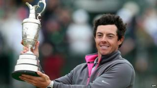 Northern Ireland's Rory McIlroy holds up the Claret Jug