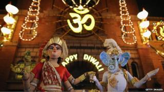 People dressed as the gods Lord Ganesha and Goddess Lakshmi walk through the streets during the Hindu festival of Diwali on November 13, 2012 in Leicester.