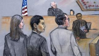 In this courtroom sketch, Azamat Tazhayakov (centre) appeared in a Boston, Massachusetts, courtroom on 21 July 2014