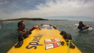 RNLI lifeguards rescue a man off Freshwater West, Pembrokeshire, in July 2014