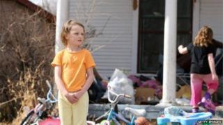 children in scruffy yard