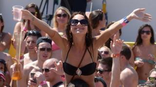A woman in a bikini poses during Spring Break in Cancun, Mexico.