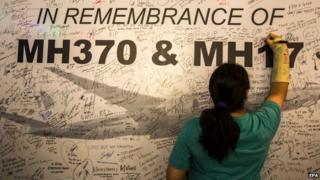 Signing a memorial wall for Malaysia Airlines MH370 and MH17 in Kuala Lumpur