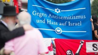 "Pro-Israel activists in Berlin hold banner saying ""Against anti-Semitism and hatred of Israel"""