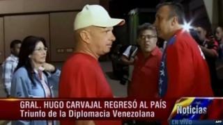 TV grab taken from Venezuelan state channel VTV showing Venezuelan Gen Hugo Carvajal (centre) as he arrives in Caracas on 27 July, 2014.