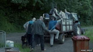 Still from Home Office campaign video showing agricultural workers