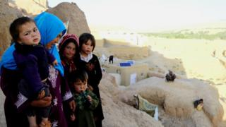 From livestock to satellite dishes: Some Bamiyan families have adapted caves to suit their needs