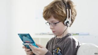 Picture of a child playing video games