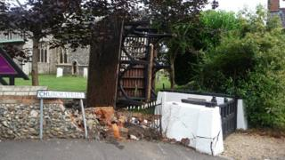 The lychgate now lies in the ground of the church after being knocked from its foundations
