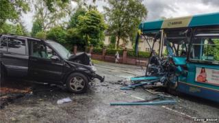 Car and bus crash in Greater Manchester