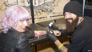 Girl getting tattoo
