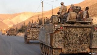 "Lebanese army""s armoured personal carriers (APC) enter the town of Arsal in the Bekaa valley by the Syrian border on 2 August 2014"