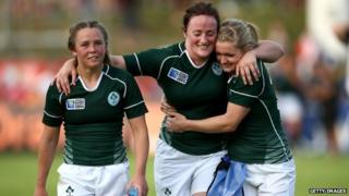 """Ashleigh Baxter, Ailis Egan and Vikki McGinn of Ireland embrace after their win during the IRB Women""""s Rugby World Cup Pool B match between New Zealand and Ireland at the French Rugby Federation headquarters on August 5, 2014 in Paris, France."""