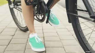Shoes of a woman on a bike
