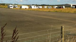 Travellers on the airfield site