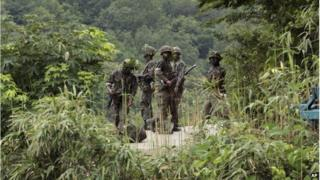 South Korean army soldiers search for a South Korean soldier who is on the run after a shooting incident in Goseong, South Korea, Sunday, 22 June 2014