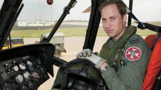 Prince William sat in a helicopter in his uniform