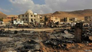 A general view shows damage and burnt tents for Syrian refugees from the fighting between Lebanese army soldiers and Islamist militants in the Sunni Muslim border town of Arsal, in eastern Bekaa Valley