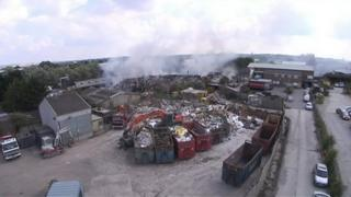 Firefighters work to bring the blaze under control