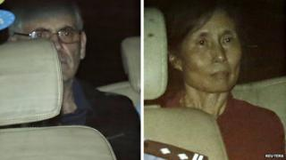 Couple leaving court in police car, 8 Aug 14