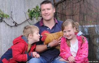 Geraint Rees with son Taran, daughter Seren, and Bomper the cockerel