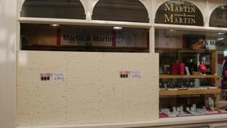 Boarded up window of Guernsey jeweller Martin and Martin after smash and grab burglary