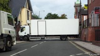 Lorry stuck in road