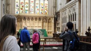 People listening to audio guides in Bath Abbey