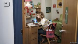 Girl in student bedroom
