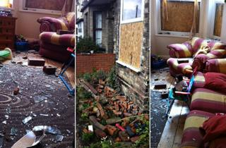 Glass and bricks strewn across the Wilson's living room